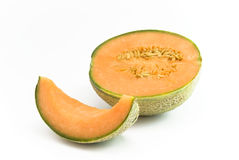 Half Melon with section. Melon half and section lying together on white background stock image