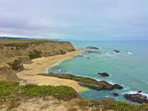Half Moon Bay Beach California. Cliffs and beach along the Pacific Ocean in Half Moon Bay Royalty Free Stock Images
