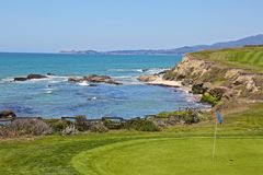Half Moon Bay golf course. The 18th hole of golf course on the Pacific Ocean in Half Moon Bay California Stock Photography