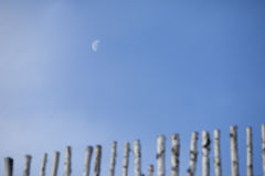 Half moon and fence Royalty Free Stock Photos