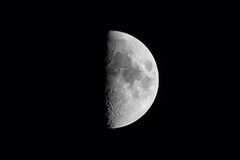 Half moon isolated against black sky Stock Image