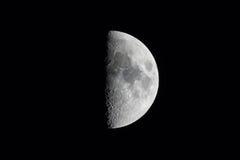 Half moon isolated against black sky Stock Image