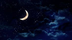 Half moon in the night sky royalty free stock image