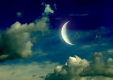 Half moon in the night sky. The moon in the night sky in clouds Stock Photography
