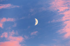 Half moon with red clouds Royalty Free Stock Photos