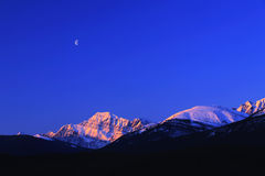 Half Moon by the Snow mountain Royalty Free Stock Photo