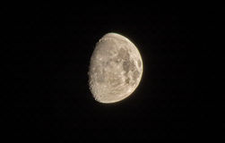Half moon. Telescopic view of the Moon (only half is enlighted and can be seen) against a black sky. Photo taken on 11th October 2016 Royalty Free Stock Photos