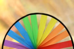 Half of a multi colored round pinwheel, bright background stock photo