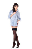 Half-naked beautiful girl in shirt and stockings. Royalty Free Stock Images