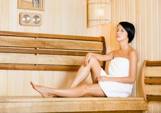 Half-naked girl relaxing in sauna Royalty Free Stock Photo