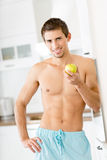Half-naked male with apple Stock Photography