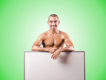 Half naked man with blank board Royalty Free Stock Image