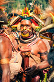 Half-naked man with drum in Papua New Guinea Stock Image