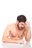 Half-naked man with headaches Royalty Free Stock Photos