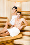 Half-naked man and woman relaxing in sauna Royalty Free Stock Photos