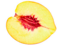 Half of nectarine fruit Royalty Free Stock Photography