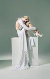 Half nude woman wearing white dress Royalty Free Stock Image