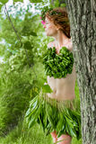 Half nude young sexy girl behind tree Stock Photos