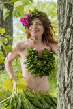 Half nude young sexy girl hiding behind tree Stock Photography