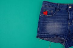 Free Half Of Red Shorts Close Up On Blue Background, In The Pocket There Is A Red Heart Stock Photos - 214380123