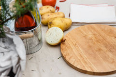 Half of Onion Sprinkle with ฺBlack Pepper with Potatoes with Wood Block on The Table with Tablocloth Royalty Free Stock Images