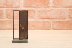 Half open brown door on wood. Stock Image