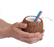Half open coconut in male hands Royalty Free Stock Photos