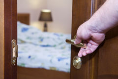 Half-open door with hand. The bedroom Royalty Free Stock Photos