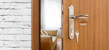 Half open door of a modern living room closeup. Royalty Free Stock Image