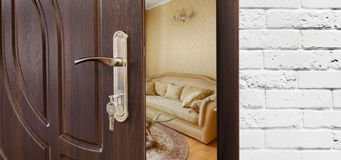 Half open door of a modern living room closeup. Royalty Free Stock Photos