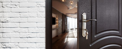 Half open door of a modern living room closeup. Royalty Free Stock Photo