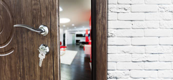 Half open door of a modern living room closeup. Half opened door to a living room. Door handle, door lock. Lounge door half open. Opening door. Welcome, privacy Royalty Free Stock Photography