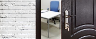 Half open door, welcome to the office. Stock Images