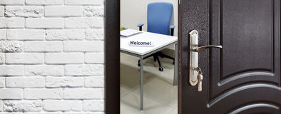 Half open door, welcome to the office. Royalty Free Stock Photos