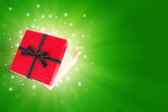 Half open gift box. With light inside out Royalty Free Stock Photo