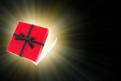 Half open gift box with light inside out Royalty Free Stock Images