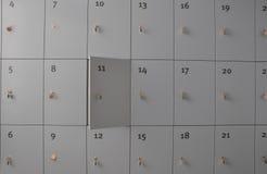Half open locker. In a wall of lockers Stock Images