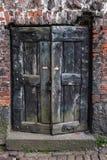The half-open old wooden door. Stock Photography