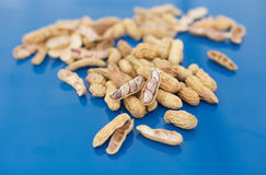Half open penut on pile of penuts Royalty Free Stock Images