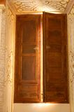 Half open window. Half-opened shutters of wood of an ancient window in La Granja Palace of Segovia, Spain Stock Photography