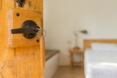 Half opened door of a bed room, key in keyhole Stock Images