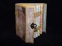 Half-opened small handmade ancient-looking photoalbum.  Stock Photos
