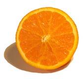 Half an orange. Orange halved stock image