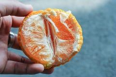 Half of orange. In closeup Royalty Free Stock Photos