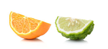 Half orange fruit and bergamot white background, fresh and juicy Royalty Free Stock Image