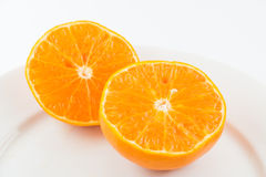 Half orange fruit on white background, fresh and juicy Stock Image