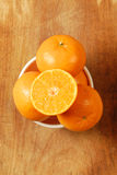 Half of orange and the orange. Stock Photo