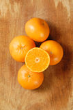 Half of orange and the orange. Royalty Free Stock Images