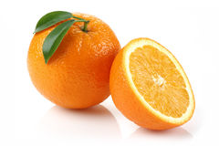 Half Orange and Orange. Half of orange on white background royalty free stock photography
