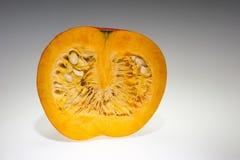 An half orange pumpkin with copy space Royalty Free Stock Photos